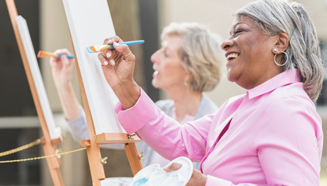 Seniors Smiling and Painting in Skilled Nursing Facility